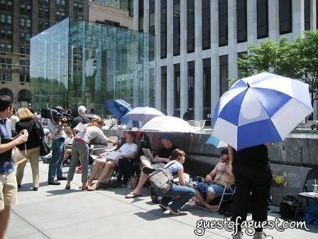 buyers waiting outside apple store, nyc