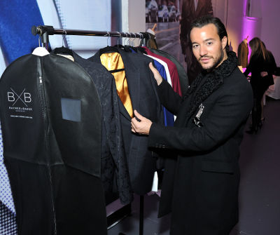 emir bahadir in Baynes + Baker King Leo menswear collection launch with Nate Burleson