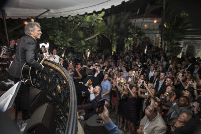 Magnums In Miami: We Partied With Bon Jovi (& His Son) At The Versace Mansion