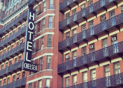 The Chelsea Hotel Doors Hiding Andy Warhol, Edie Sedgwick & Bob Dylan Are Being Auctioned