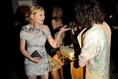 Kirsten Dunst takes a look at one of the CFDA Award Statues