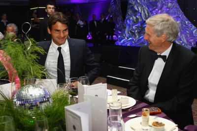 Roger Federer and Wimbledon chairman Tim Phillip