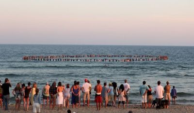 NYC Skateboard Legend, Andy Kessler, Honored In A Sunset Paddle Out In Montauk