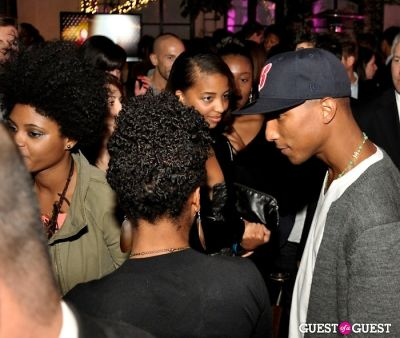 Pharrell with fans at Qream launch