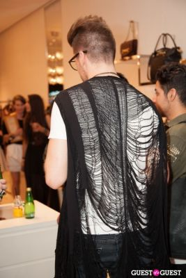 both shredded-vest in Moschino Celebrates Fashion's Night Out 2012