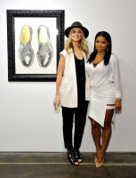 L-R: Artist Elizabeth Waggett and Mashonda Tifrere attend the Art LeadHERS exhibition opening at Joseph Gross Gallery in New York, NY on May 5, 2016.  (Photo by Stephen Smith)