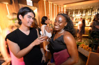 CHICAGO, IL - JULY 22: (L-R): Samm Mackin and Bolaji Sosan photographed during Molly Guy's Chicago Soiree in Bloom curated with Cointreau and Guest of a Guest on Friday, July 22, 2016 at The James Chicago hotel in Chicago, Illinois. (Photo by Randy Belice)