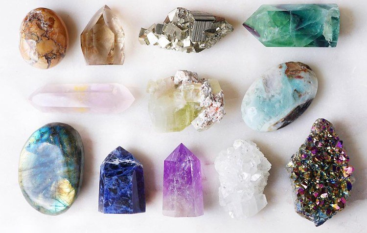 Crystals including Labradorite, Jasper, and Quartz on a white backdrop