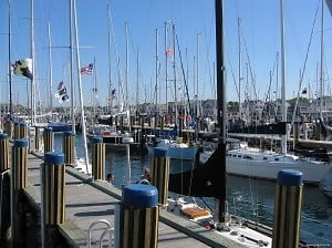 Boats Raft Up to Town Pier