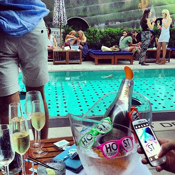 Popping bottles by the pool