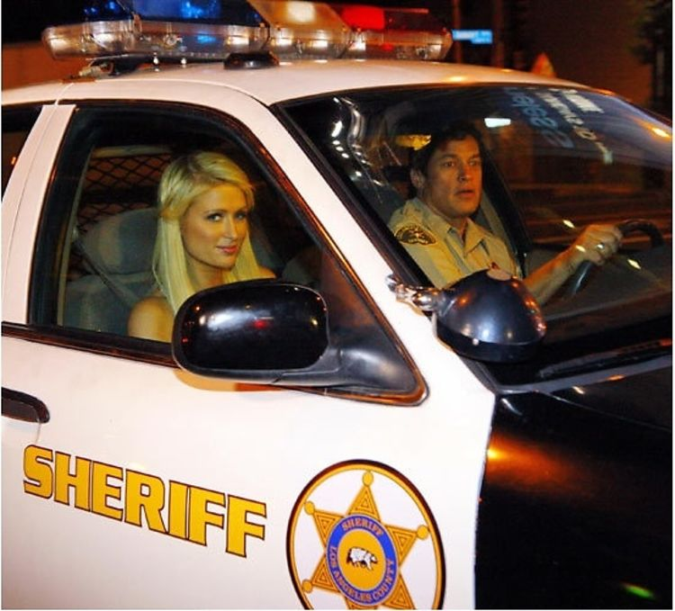 Paris Hilton Cruises By Us On Sunset In A Cop Car