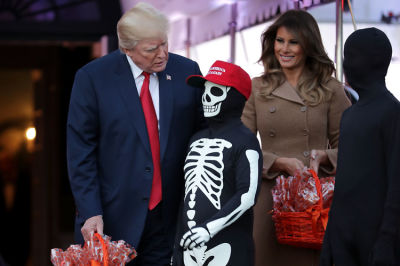 WTF Is Going On In These Photos Of Donald Trump With White House Trick-or-Treaters?
