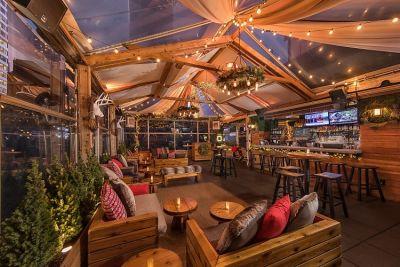 Get Naughty At NYC's Most Festive Holiday Bars