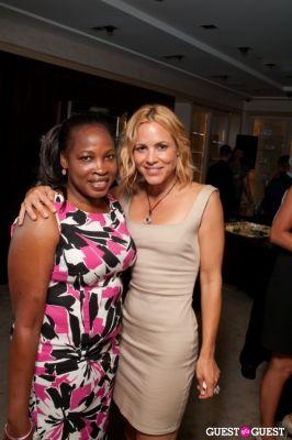 maria bello in Judith Leiber's Haiti Pendant Initiative