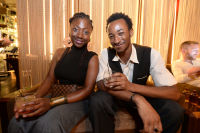 CHICAGO, IL - JULY 22: (L-R): Marquima Watts and Marshawn Young photographed during Molly Guy's Chicago Soiree in Bloom curated with Cointreau and Guest of a Guest on Friday, July 22, 2016 at The James Chicago hotel in Chicago, Illinois. (Photo by Randy Belice)