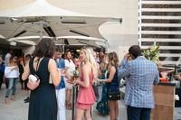 Guests gather poolside at the Cointreau Soiree at the Joule Dallas Hotel in Dallas, Texas on August 11, 2016.