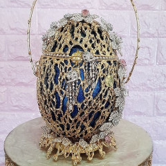 The World's Most Expensive Handbag Is A $6.7 Million Easter Egg Purse Covered In Diamonds
