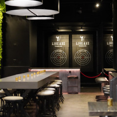 Manhattan's First Axe-Throwing Bar Is Actually Super Swanky (& Full Of Photo Ops)