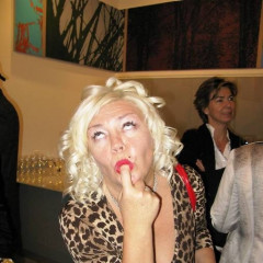 Marilyn Monroe Look-Alike Exhibits Art In The City