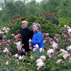 Hillary Clinton And Afghan President Karzai Stop To Smell The Roses