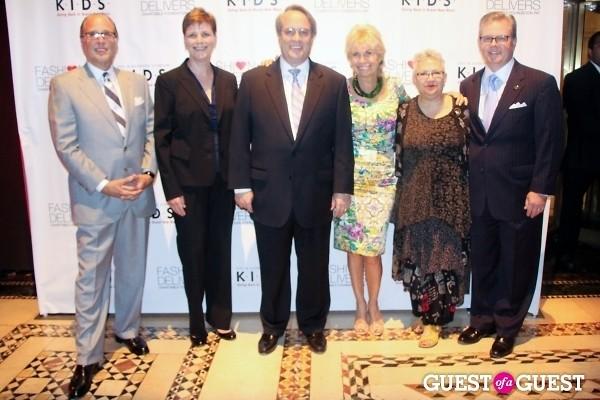Fashion Delivers Chairman Allan Ellinger Women In Industry Luncheon Committee co-chair Meg Ostrom Gerber Childrenswear President